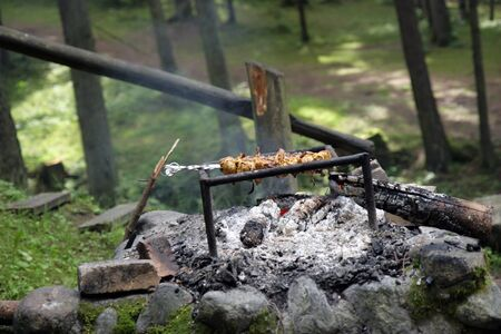 Prepared meat above the fire