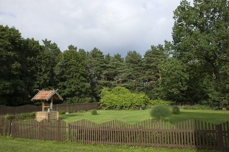 Water well in backyard in cloudy day photo
