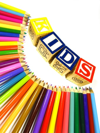 Rainbow of colour pencils with learning blocks making a word kids Stock Photo