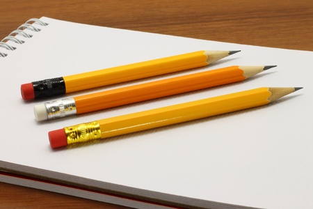 assignment: Notpad and pencils Stock Photo