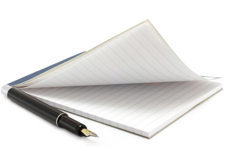 Open notepad and pen on a white background photo