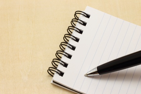 Writing pen on the notepad photo