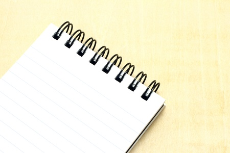 Open notepad close-up on a wooden background photo
