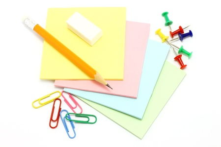 printer drawing: Colour paper with drawing pins and clips and pencil on a white background Stock Photo