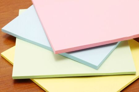 colored paper: Colour paper on a wooden background