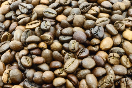 Coffee beans texture close-up for background photo