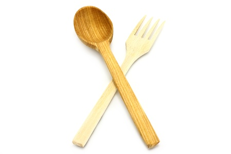 cooking ware: Wooden kitchen-ware on a white background Stock Photo