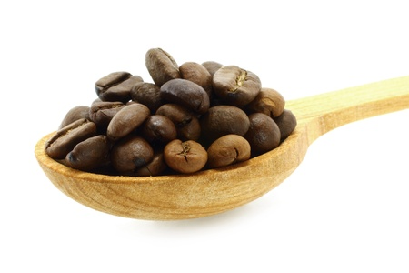 Coffee beans in a wooden spoon close-up on a white background photo