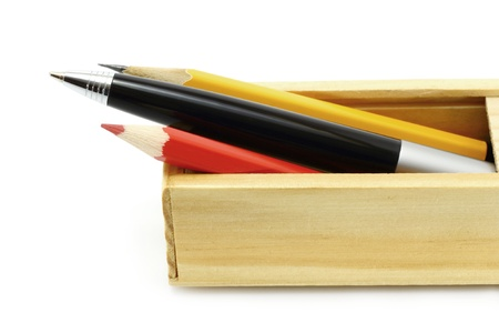 Pen and pencils in the box on a white background Stock Photo - 10831756