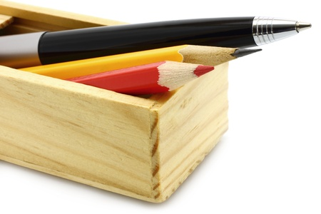 Pen and pencils in the box on a white background Stock Photo - 10831761