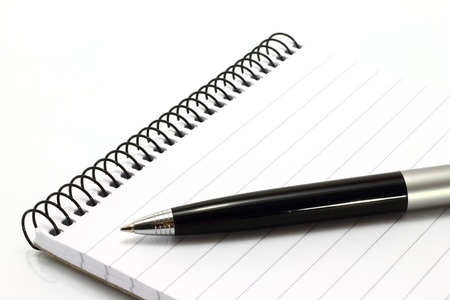 note pad and pen: Notepad with ball pen on a white background