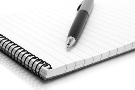 Notepad with ball pen on a white background photo