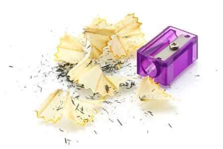 sharpened: Pencil sharpener and wooden shavings on a white background Stock Photo