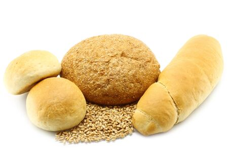 Bread and buns with wheat on a white background photo