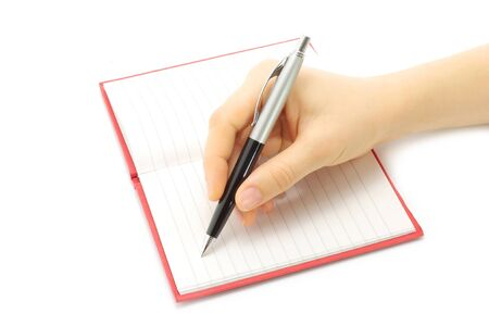 Writing woman hand in notepad on a white background photo
