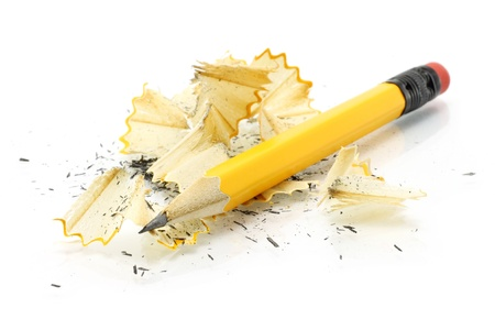 sharpen: Sharpening pencil and wood shavings on a white background
