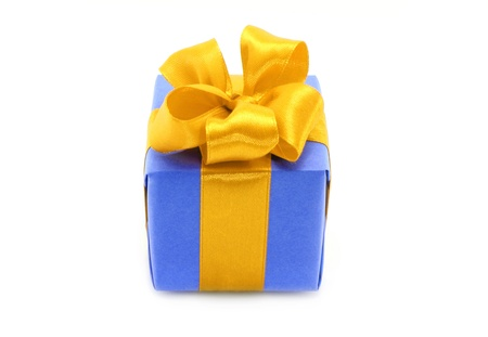 Present box with gold bow on a white background  photo