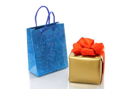 Shopping bag and gold present on a white background  photo