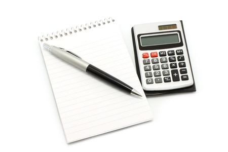 pads: Notepad with ball pen and calculator on a white background Stock Photo