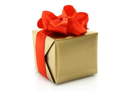 Gold present box with red bow on a white background photo