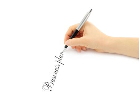 Writing woman hand on a white background  photo