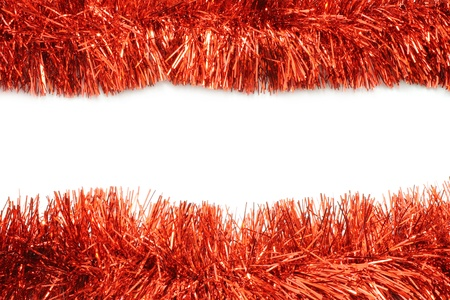 Red tinsel frame close-up on white background photo