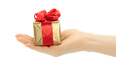 Hand holds present box on a white background photo