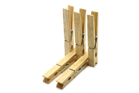 Five clothespins close-up on a white background photo