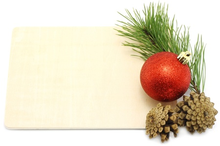 Christmas ball with pinecone and fir tree on a wodden board close-up photo
