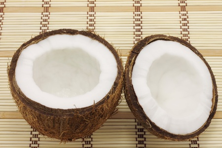 Two parts of coconut on wooden background photo