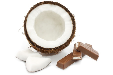 coconut milk: Fresh coconut and chocolate on white background
