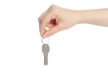 Human hand and keys isolated on white background  photo