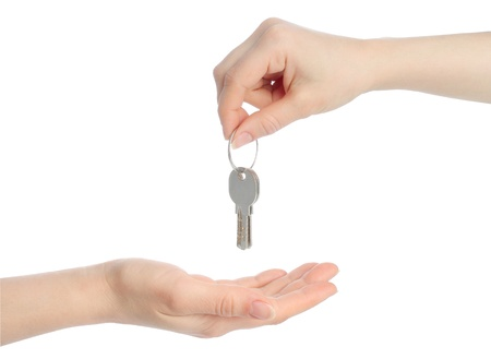 Human hands and keys isolated on white background  photo