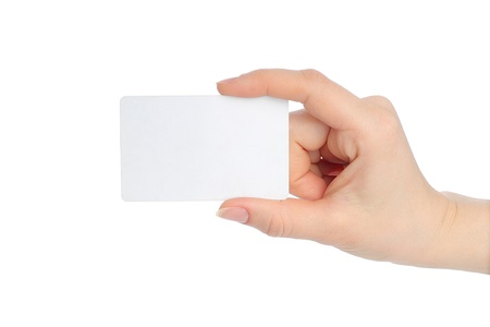 cash dispenser: Hand holds charge card on white background