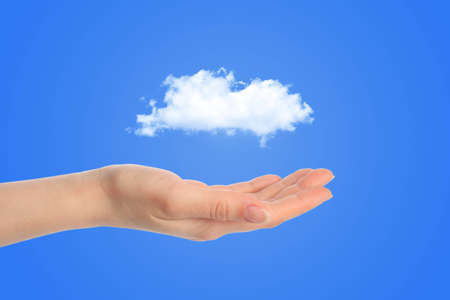Hand and a white cloud concept for background Stock Photo - 12727659