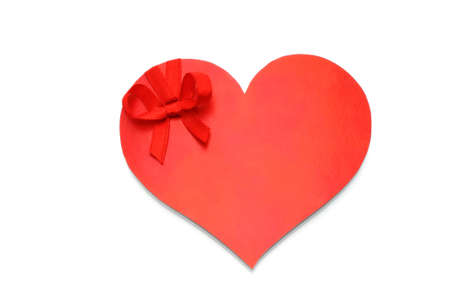 Heart with red bow on white background  photo