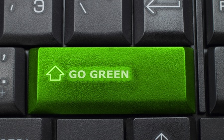 green planet: Go green button on keyboard background Stock Photo