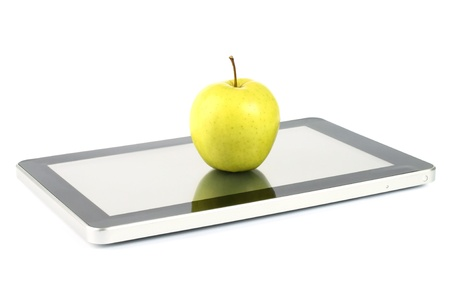 Touch screen device with a green apple on white background photo