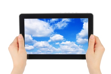 Touch screen device with blue sky in woman hands on white background Stock Photo - 13060395
