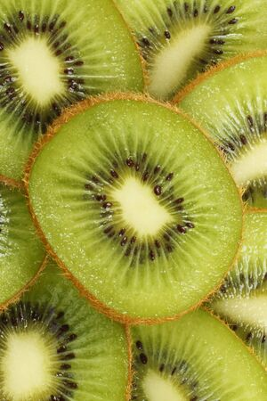 organics: Background of cut kiwi fruit