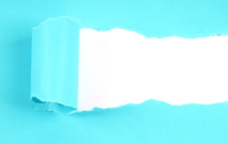 Blue tore paper with copy space photo