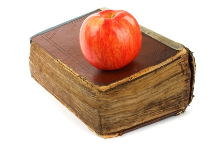 tattered: Old book with apple on a white background  Stock Photo