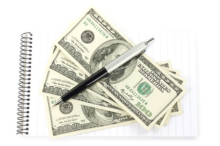 Money and pen with notepad on white background photo