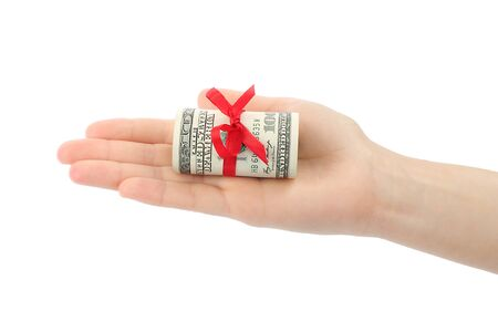 Hand with money present on white background photo