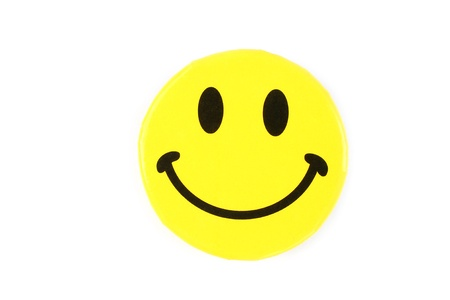 laugh emoticon: Yellow happy face pin on white background