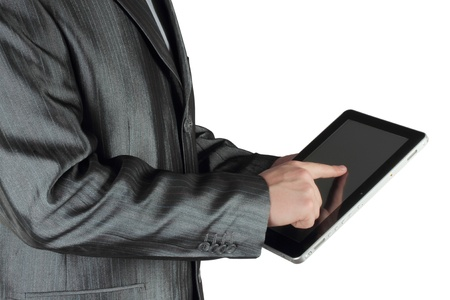 Businessman using touch screen device on white background photo