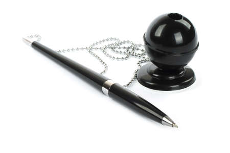 ballpoint pen: Black ballpoint pen with chain and stand  Stock Photo