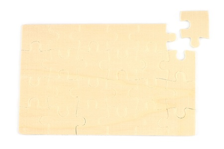 conundrum: Wooden puzzles on white background Stock Photo
