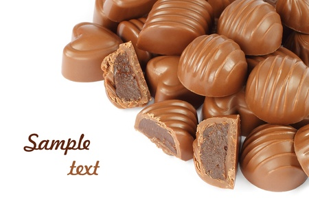 Assorted chocolate candies on white background photo