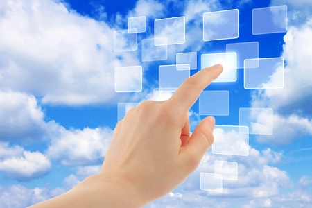 Cloud computing concept with woman hand Stock Photo
